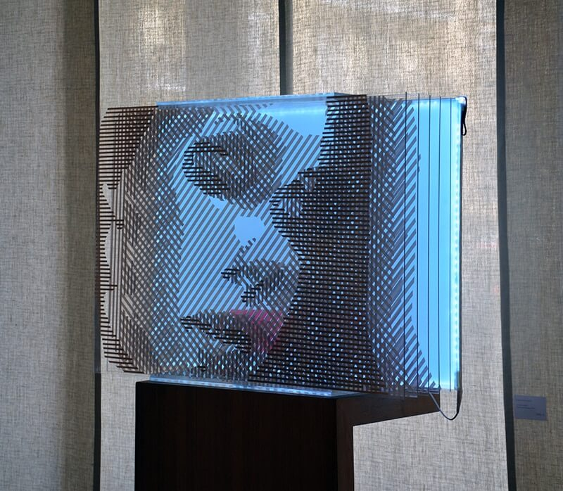 FAQlove Reloaded- optical art female portrait out of packing tape- side view