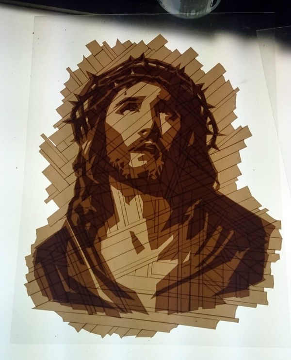 The emergence of tape art Jesus portrait from package tape