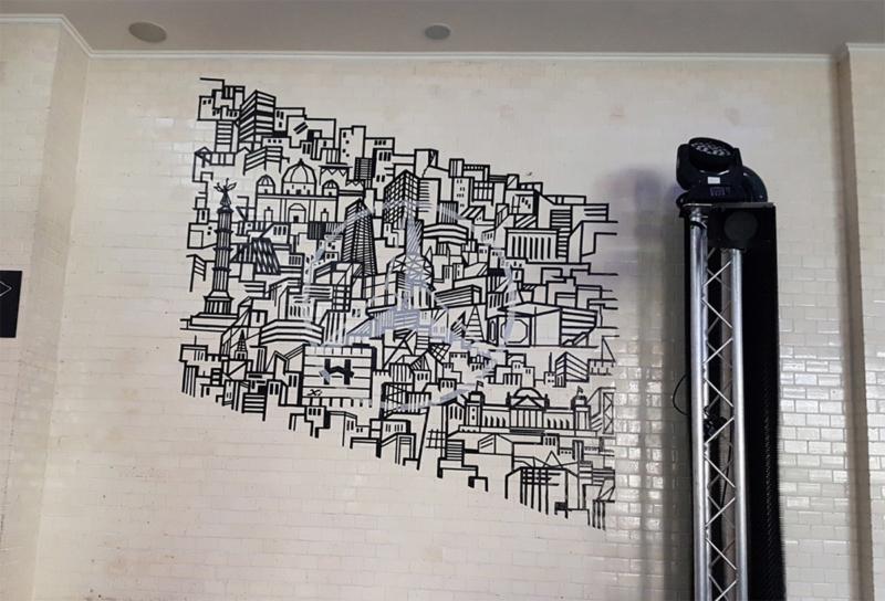 Mercedes star logo as skyline-adhesive tape graffiti wall art