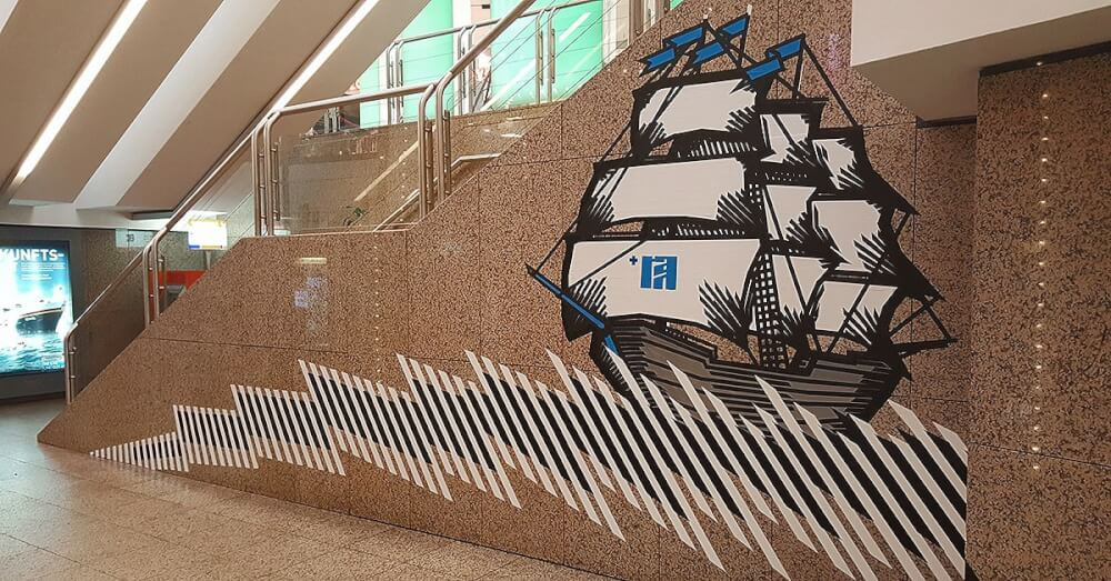 Artist's hands-live gluing of tape mural- closeup