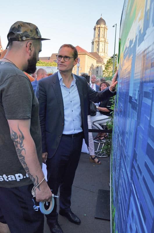 Berlin Mayor Mueller and tape artist Ostap