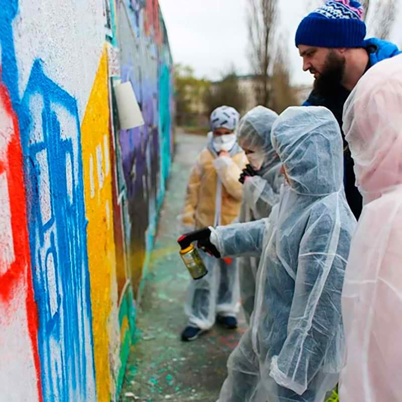 Graffiti kids at spraying- A workshop with Berlin street artist